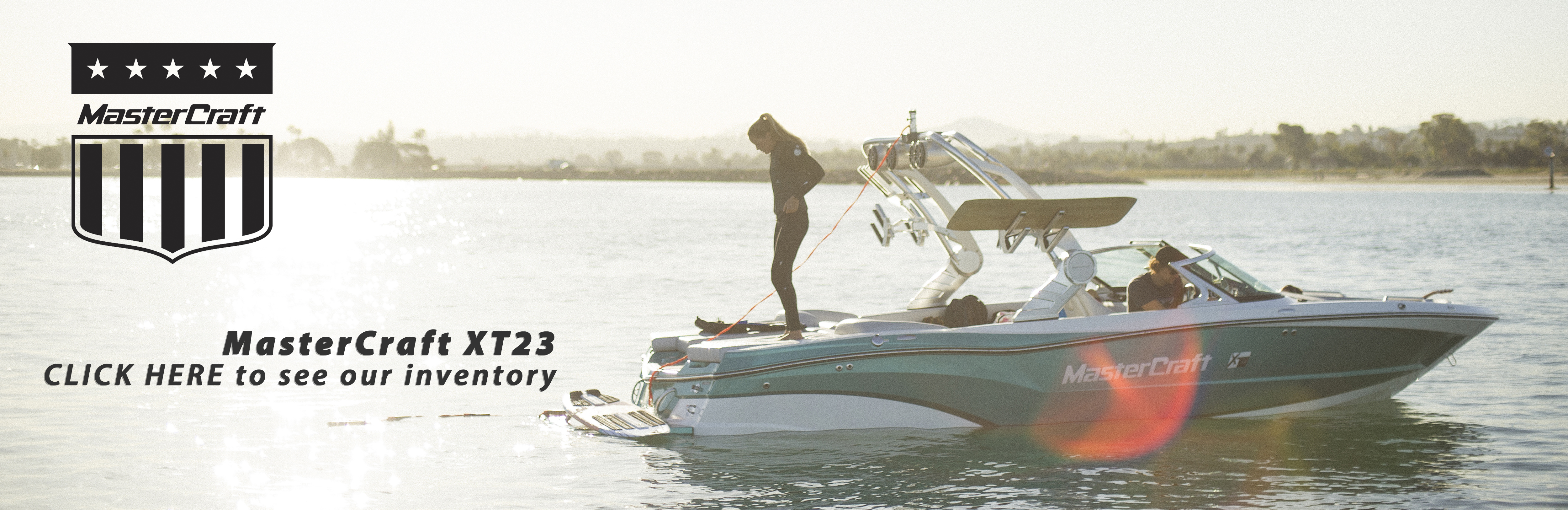 Banner - MasterCraft XT23 with pretty girl on back