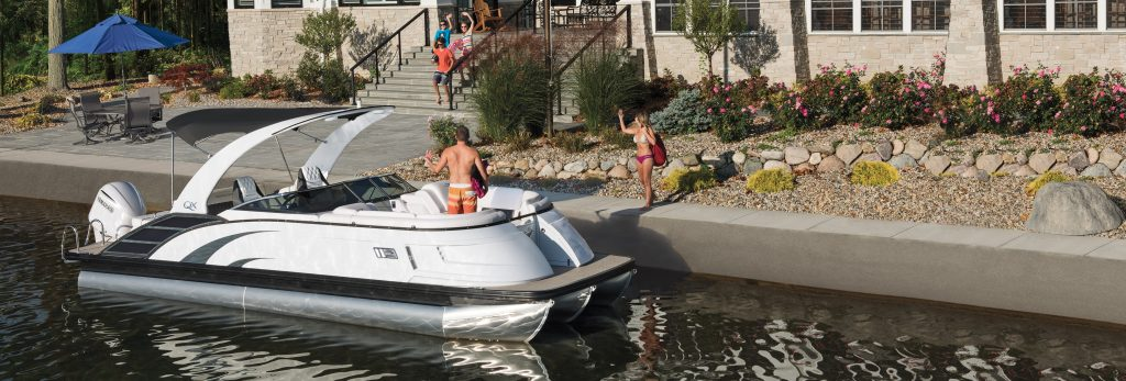 Bennington QX on dock with woman in bikini waving