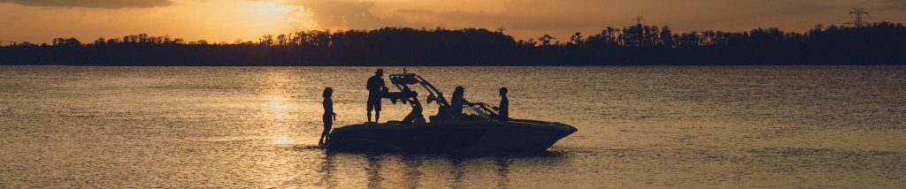 MasterCraft on the lake at sunset